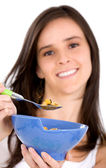 Healthy girl eating cereal — Stock Photo