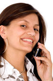 Friendly woman smiling on the phone — Stock Photo