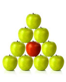 Green apples on a pyramid shape - be different — Stock Photo