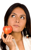 Apple girl - full of thoughts — Stockfoto