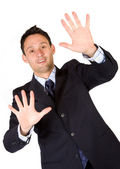 Business man with hands on the screen — Stock Photo