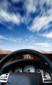 Fast sports car steeringwheel — Stock Photo