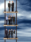 Corporate ladder - business team work — Stock Photo