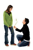 Casual man offering a flower to a girl — Stock Photo