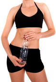 Fit body with a water bottle — Stock Photo