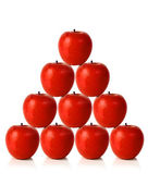 Red apples on a pyramid shape — Stock Photo