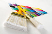 Paint brushes with color guide — Stock Photo