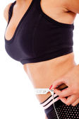 Woman measuring her waist — Stock Photo