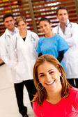 Patient with a group of doctors — Stock Photo