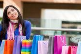 Thoughtful shopping woman — ストック写真