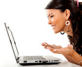 Confused woman with laptop — Stock Photo
