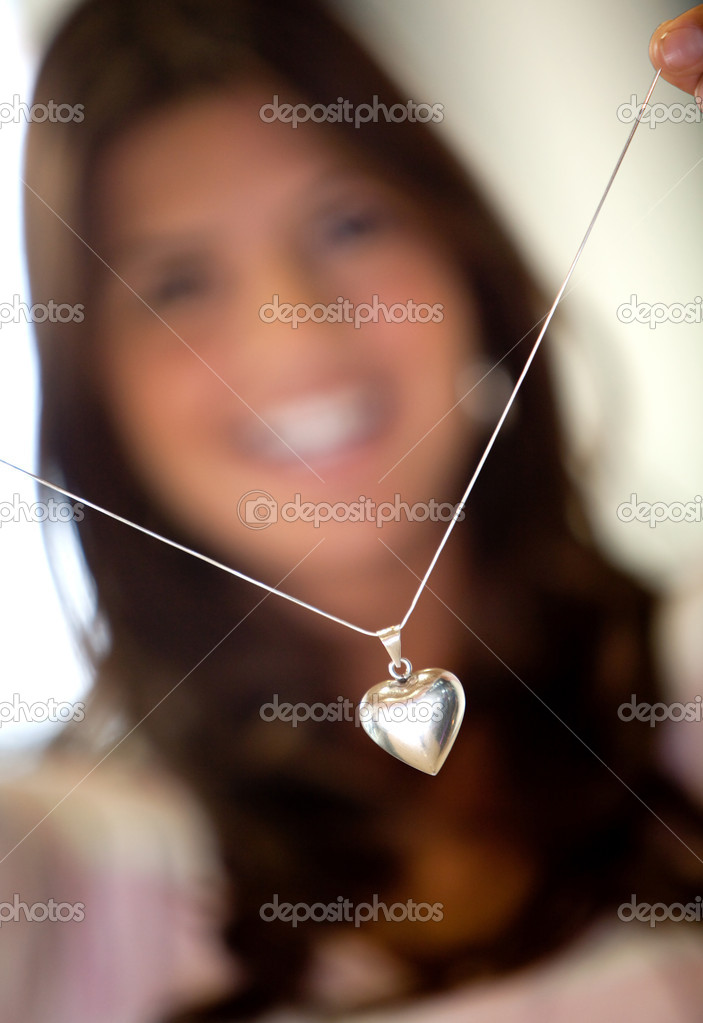 Woman trying a beautiful silver heart shaped necklace — Stock Photo #7750684