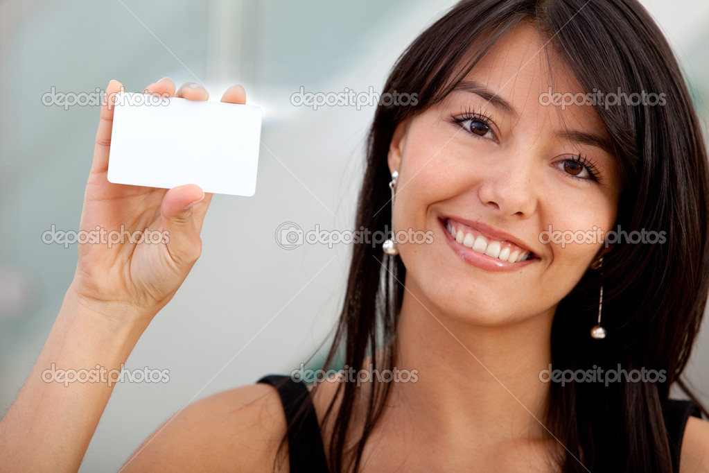 Woman displaying a personal business card at the office — Stock Photo #7750760