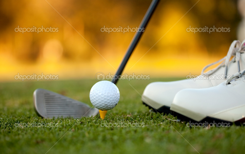 Golf player hitting the ball close-up on shoes — Stock Photo #7750801
