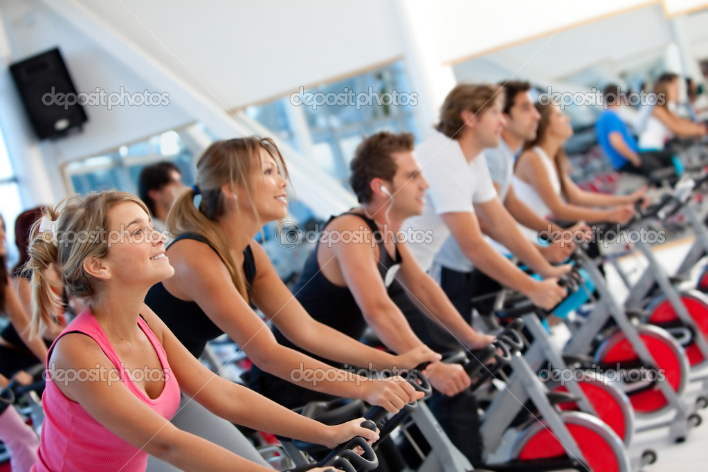 Group of gym on spinning machines — Stock Photo #7751101