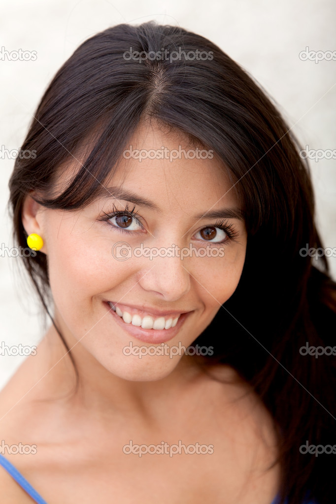 Portrait of a beautiful woman smiling indoors  Stock Photo #7751792