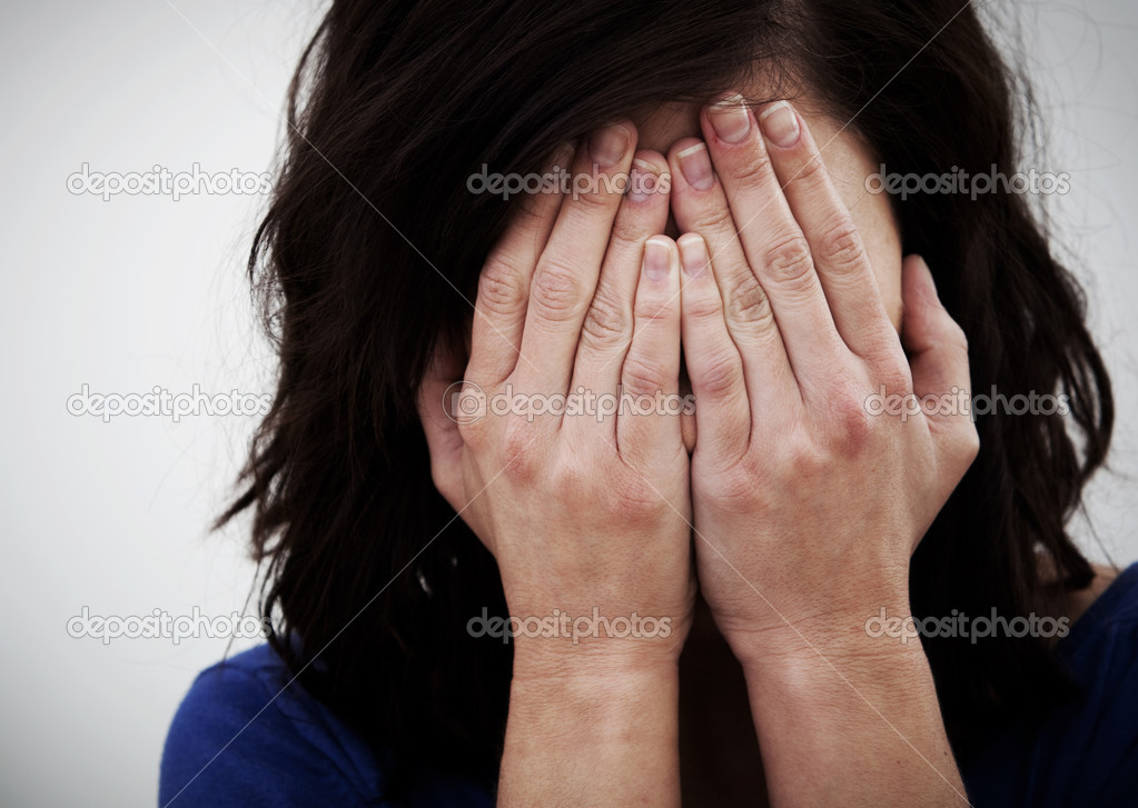 Desperate woman covering her face with her hands — Stock Photo #7751892