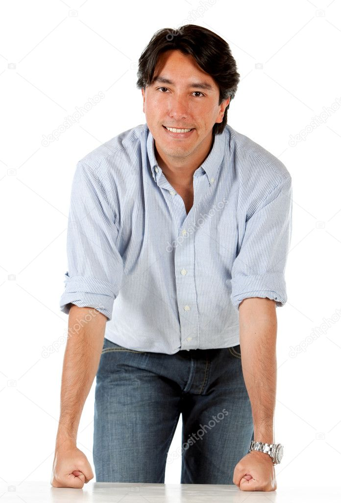 Casual man leaning on a table isolated over a white background — Stock Photo #7752464