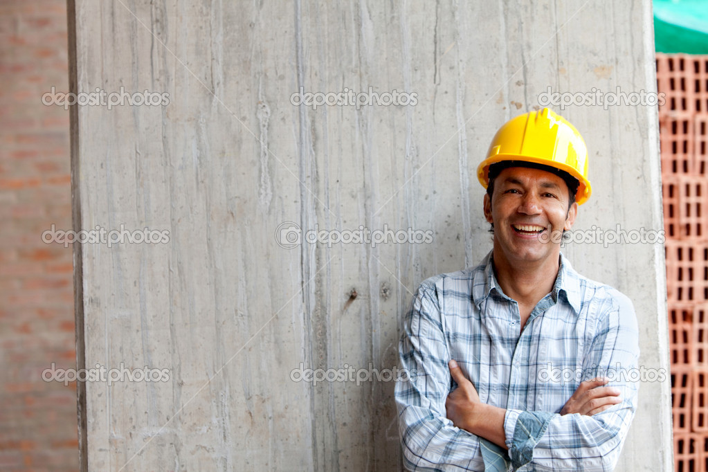 Male construction worker at a building site smiling — Stock Photo #7752661