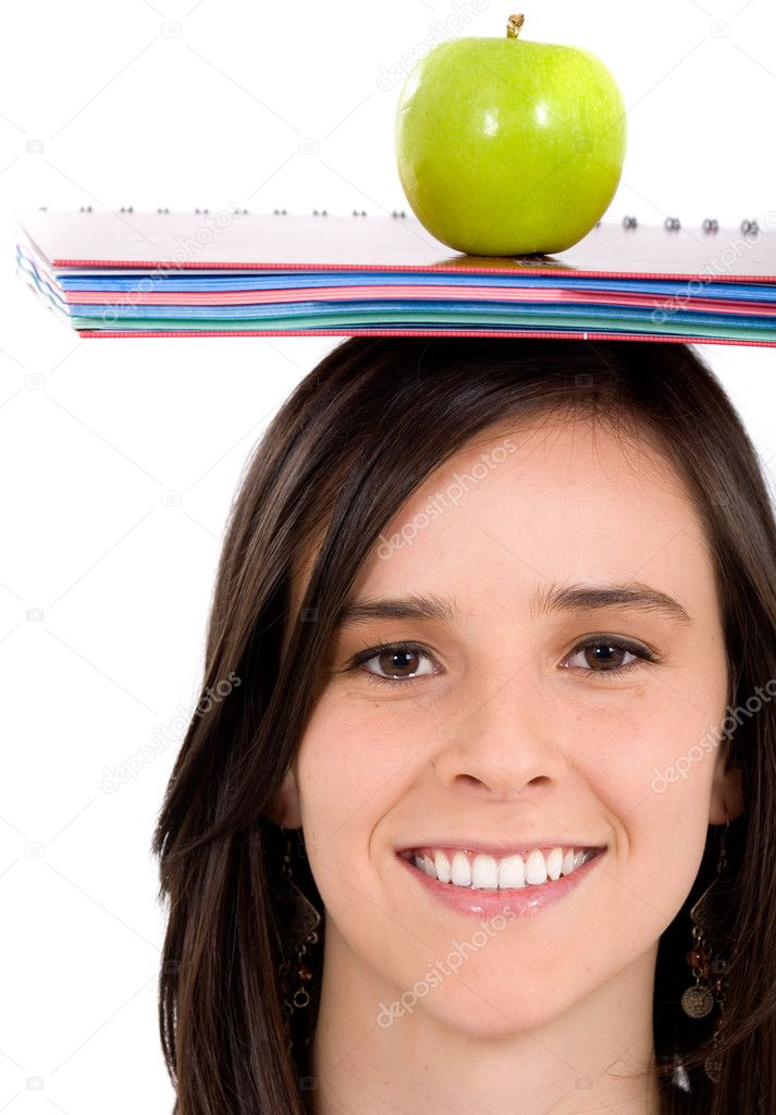 Casual intelligent student with a notepad and an apple on her head - isolated over a white background — Stock Photo #7754314