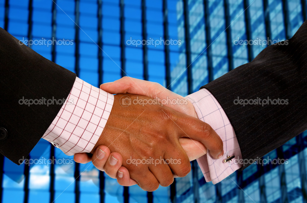 Diverse business men shaking hands in a corporate environment — Stock Photo #7754976