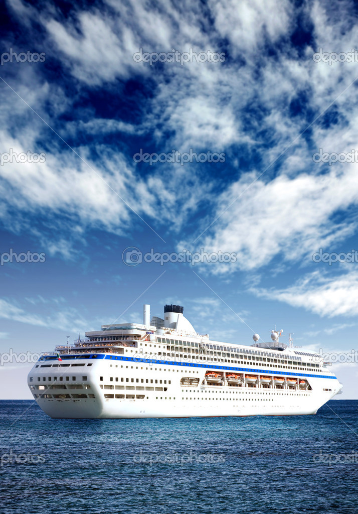 Cruise liner in open sea with a beautiful blue sky behind it — Stock Photo #7755043