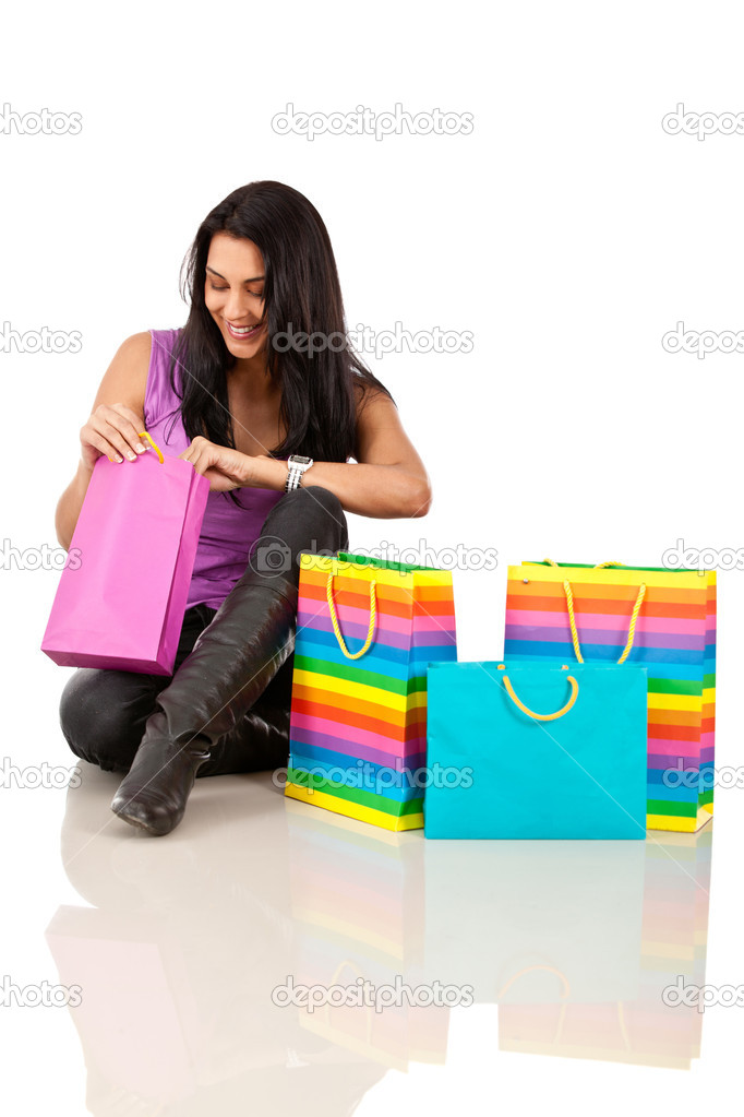 Woman peeking into shopping bags - isolated over white — Stock Photo #7755491