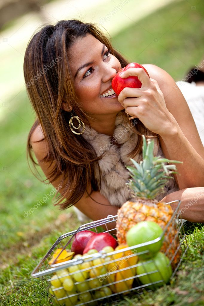 Healthy eating woman with a basket of fruits  outdoors  Stock Photo #7755735
