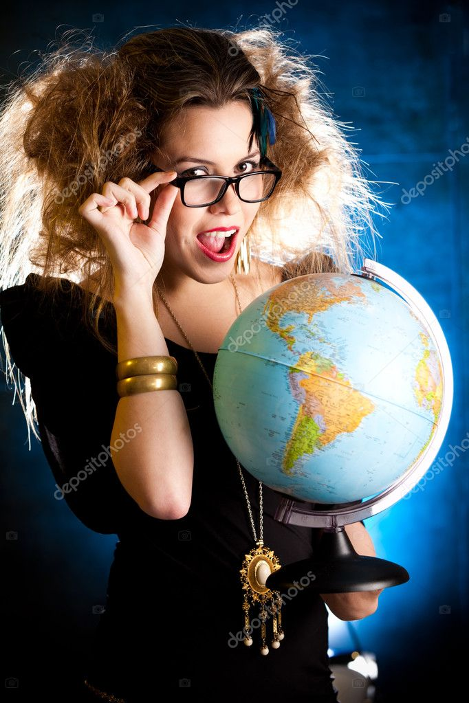 Crazy woman with messy hairdo holding a globe — Stock Photo #7756182