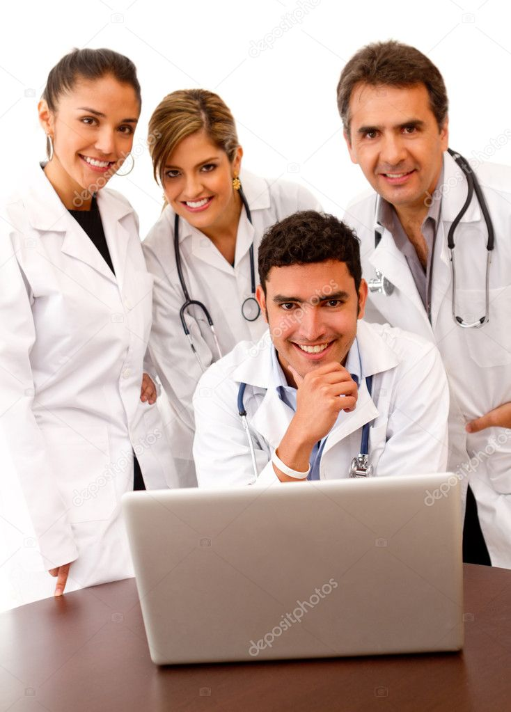 Group of doctors with a laptop Ð isolated over white — Stock Photo #7756571