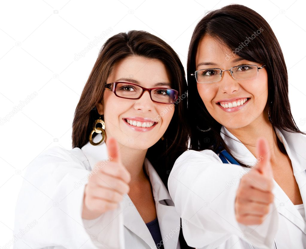 Friendly female doctors with thumbs up - isolated over white — Stock Photo #7756814