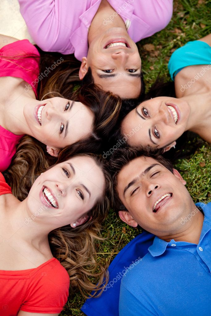 Happy group of friends lying on the floor outdoors — Stock Photo #7757053