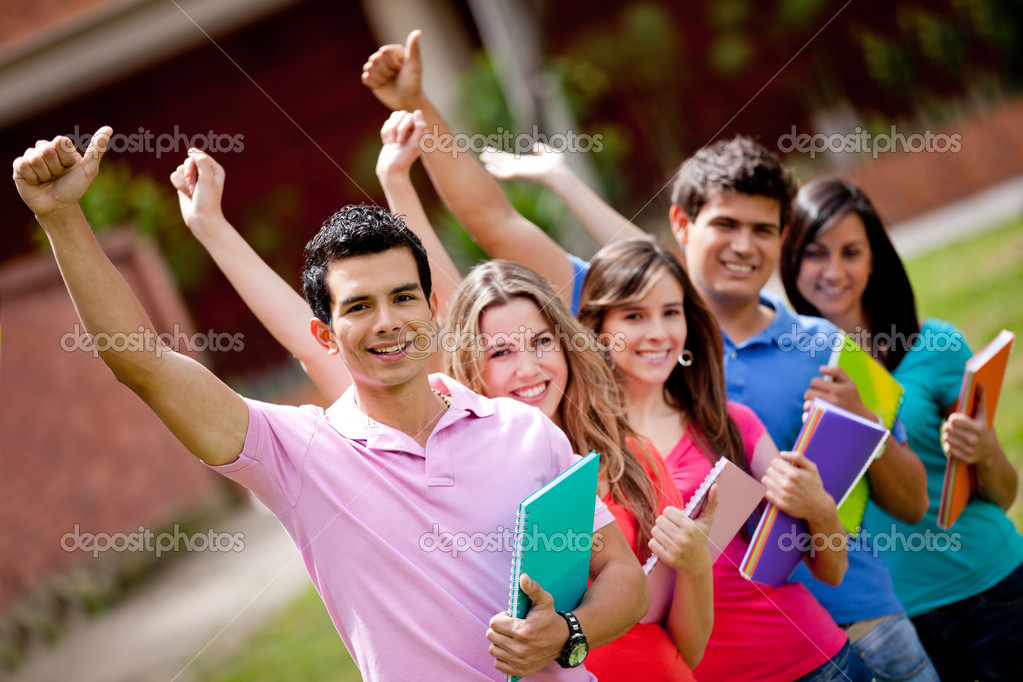 Happy group of students with arms up outdoors — Stock Photo #7757335