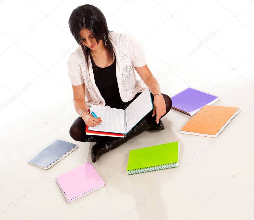 Female student sitting on the floor with notebooks around — Stock Photo #7757706
