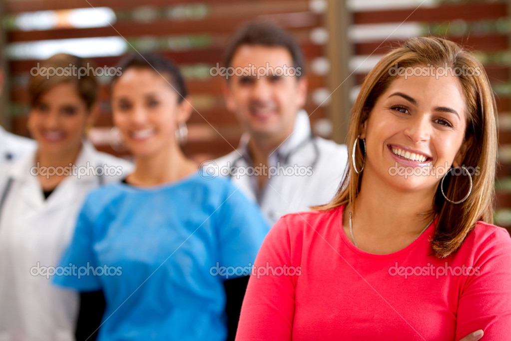 Patient with a group of doctors at the hospital — Stock Photo #7757779