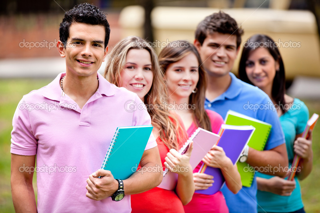 Group of students with a notebook outdoors — Stock Photo #7758124