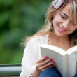 Woman reading outdoors — Stock Photo #7760149