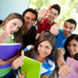 Students with thumbs up — Stock Photo #7760230
