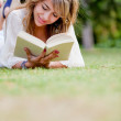 Woman reading outdoors — Stock Photo #7760273