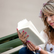 Woman outdoors reading — Stock Photo #7760326