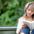Woman outdoors reading — Stock Photo #7760329