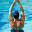 Male swimmer stretching — Stock Photo #7761481