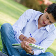 Man studying outdoors - Photo