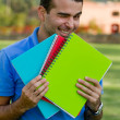 Happy male student - Stockfoto