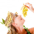Greek goddess eating grapes - Stock Photo