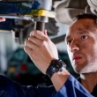 Foto Stock: Mechanic in garage