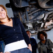 Woman at the mechanic — Stock Photo #7761779