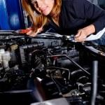Woman at the mechanic — Stock Photo