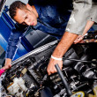 Mechanics in a garage - Stock Photo