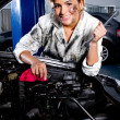 Mechanic in a garage - Stock Photo